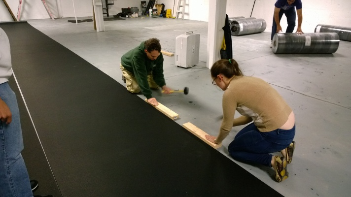 Kevin and Ann hammering 2nd piece of floor.