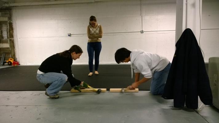Sarah and Arthur adjust 3rd piece of floor.