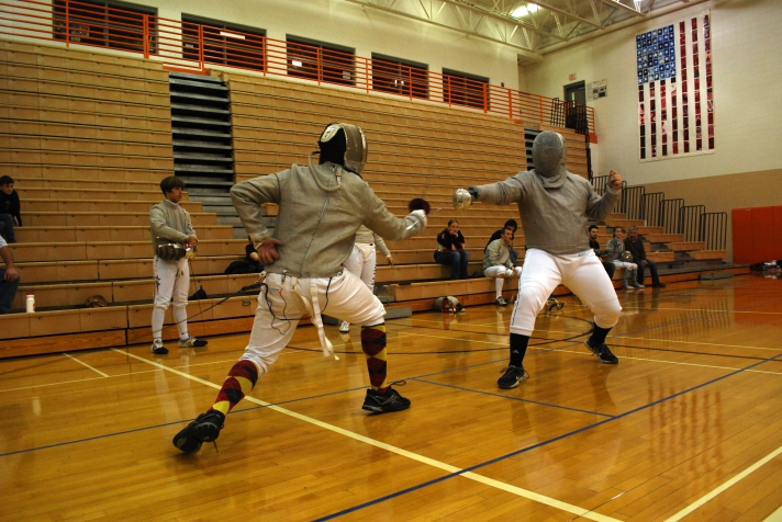RDF fencer Shelton goes for a counterattack in the saber event