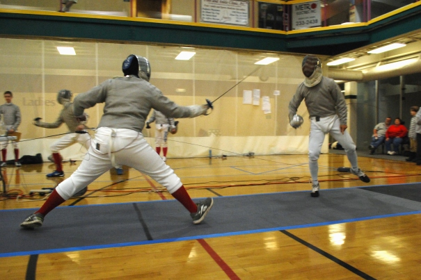 Sam lunges at an opponent.