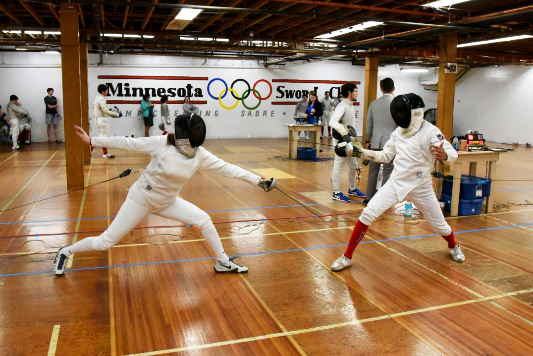 Julia scores a low-line touch in Open epee.