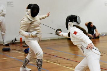 Sarah makes a hit in Open epee.