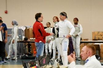 Coach Kevin talks to Jim during a 1-minute break in a 15-point bout.