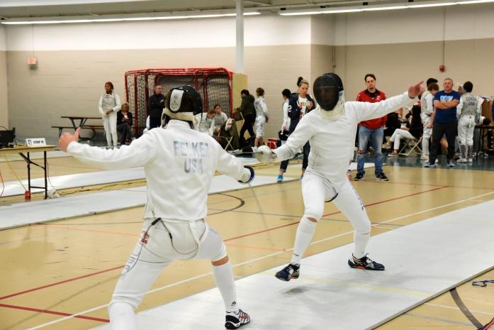 Jim on the attack in Senior Men's Epee.