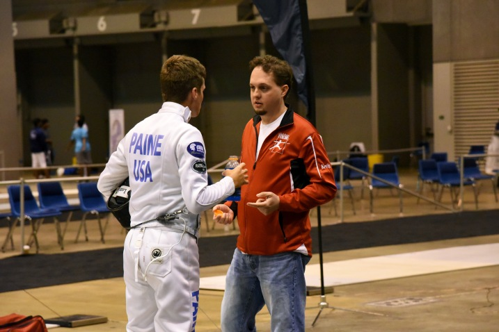 Kevin coaches Jared in Div 2 Men's Epee at Summer Nationals in St. Louis.