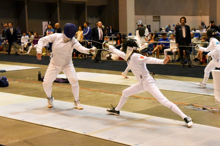Sarah makes an attack in Div 2 Women's Epee at Summer Nationals in St. Louis.