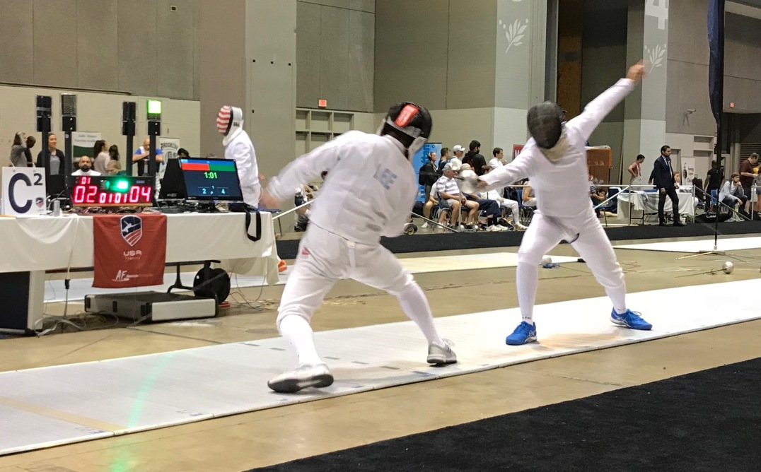 Jim (right) scores a touch in Vet-40 Men's Epee at Summer Nationals in St. Louis.