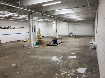 First round of painting, patching the floor, and electrical installation complete!