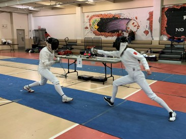 Sarah (right) makes an attack in the Div 1A Women's Epee finals