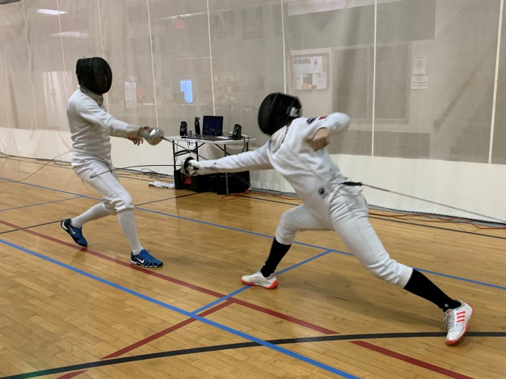 Evan cleverly changes targets to score on his opponent's leg in Mixed Epee at the Sioux City Challenge