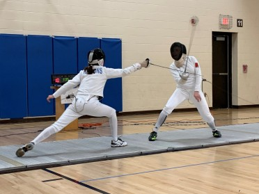 Sarah and Kaley fence for gold in Women's Epee
