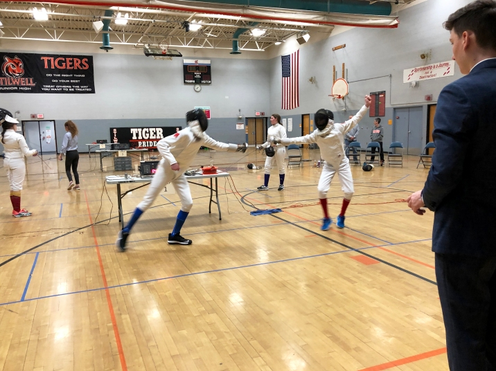 Alex and Weston fence in Mixed Epee at the Bengal Invitational
