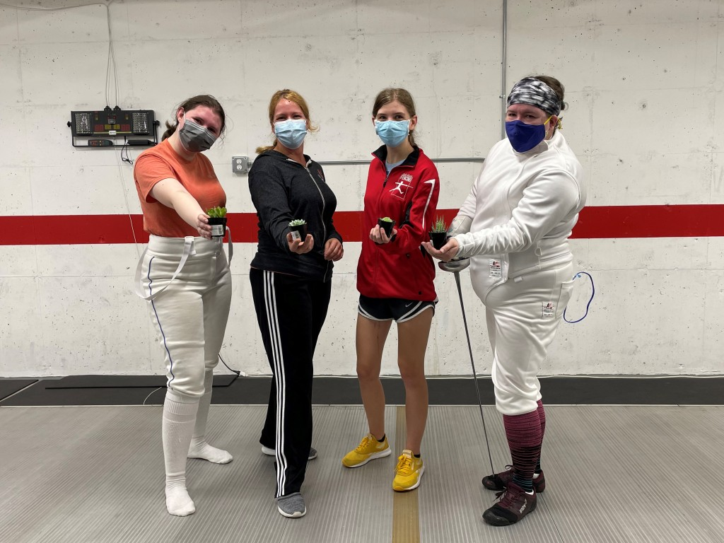 Women's Epee Top 4: Eva (2nd), Heather (3rd), Ava (3rd), Anna (1st), standing together holding their succulents